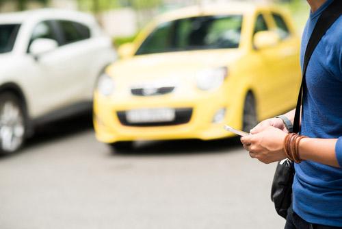 [cml_media_alt id='3149']Pedestrian texting at a busy crosswalk[/cml_media_alt]