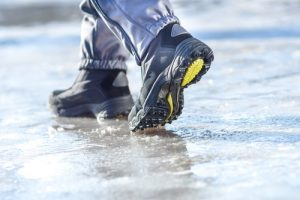 An icy, uneven sidewalk where slip, trip and fall accidents may likely take place.
