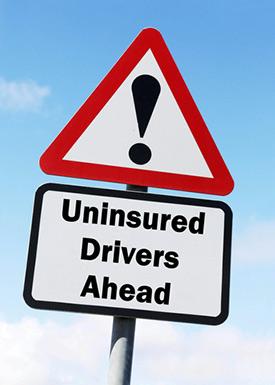 Uninsured motorist ahead sign