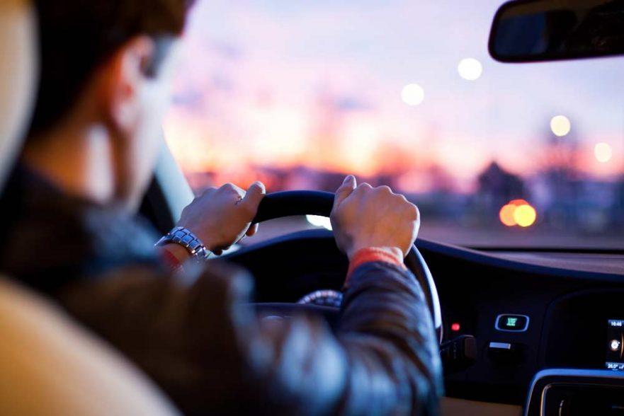 Man driving at dusk