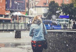 Girl walking through snow and ice
